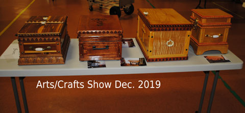 table of crafted boxes at art show in 2019