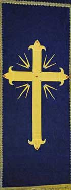 gold cross on blue banner