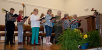 Adult Choir singing at the CLC note burning service