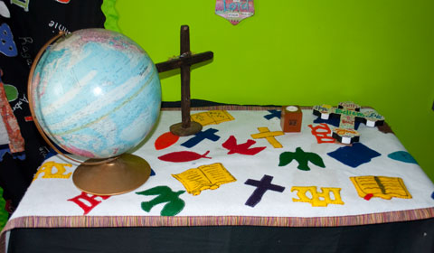 picture of table with globe and missions symbols
